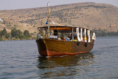Cana Gallilee Woman. A tour boat is seen on the Sea of Galillee in Israel Stock Image