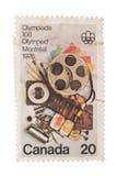 CANADÁ - CIRCA 1976: Un sello impreso en las demostraciones Communi Fotografía de archivo libre de regalías
