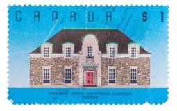 CANADÁ - CIRCA 1989: un sello impreso en las demostraciones Runnyme Fotos de archivo