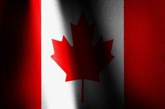 Canadá señala imágenes por medio de una bandera Foto de archivo libre de regalías