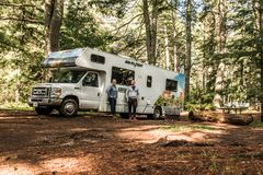 Canada Algonquin National Park 30.09.2017 couple in front of Parked RV camper Lake two rivers Campground Cruise America stock photography