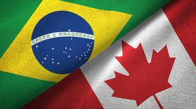 Canada and Brazil two flags textile cloth fabric texture royalty free stock images