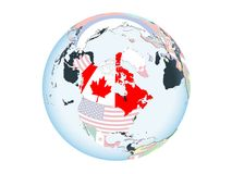 Canada with flag on globe isolated. Canada on bright political globe with embedded flag. 3D illustration isolated on white background Royalty Free Stock Photography