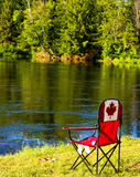 Canada chair at the water edge Stock Photography