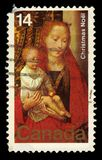 Virgin and Child, painting by Hans Memling. CANADA - CIRCA 1978: A stamp printed in Canada shows painting by Hans Memling, `The Virgin and Child with St. Anthony stock images
