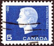 CANADA - CIRCA 1962: A stamp printed in Canada shows Queen Elizabeth II and Agriculture symbol, circa 1962.