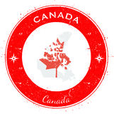 Canada circular patriotic badge. Grunge rubber stamp with national flag, map and the Canada written along circle border, vector illustration Stock Images