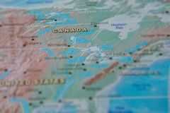 Canada in close up on the map. Focus on the name of country. Vignetting effect.  royalty free stock photo