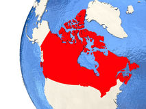 Canada on 3D globe. Map of Canada on globe with watery blue oceans and landmass with visible country borders. 3D illustration Stock Images