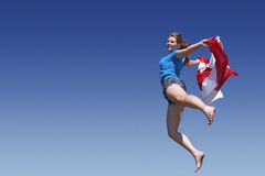 Canada Day. A young girl celebrating with the Canadian flag royalty free stock images