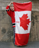 Canada Day. Man holding up Canadian flag for Canada Day on July 1st Royalty Free Stock Images
