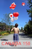 Canada day 150. Boy with Birthday balloons. stock photography