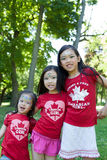 Canada Day Celebration. Three young girls celebrating Canada's 145th Birthday Stock Photography
