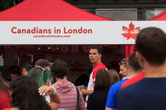 Canada Day 2017 celebrations in London. Canada Day celebrations 2017 in Trafalgar Square in London. Crowds of happy people wearing Canadian colours enjoy the stock photography