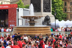 Canada Day 2017 celebrations in London. Canada Day celebrations 2017 in Trafalgar Square in London.  Crowds of happy people wearing Canadian colours and sporting Royalty Free Stock Image