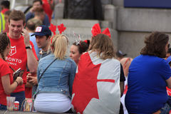 Canada Day 2017 celebrations in London. Canada Day celebrations 2017 in Trafalgar Square in London.  Crowds of happy people wearing Canadian colours and sporting Stock Image