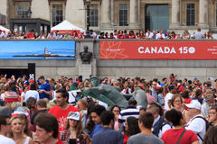 Canada Day 2017 celebrations in London. Canada Day celebrations 2017 in Trafalgar Square in London.  Crowds of happy people wearing Canadian colours and sporting Stock Photos