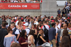 Canada Day 2017 celebrations in London. Canada Day celebrations 2017 in Trafalgar Square in London.  Crowds of happy people wearing Canadian colours and sporting Royalty Free Stock Photos