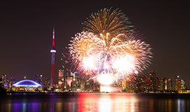Canada Day Fireworks. TORONTO, CANADA - 30TH JUNE 2014: Fireworks in Toronto for Canada Day showing the City and local landmarks Royalty Free Stock Photo