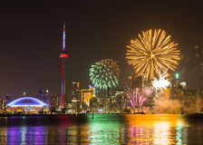 Canada Day Fireworks. TORONTO, CANADA - 30TH JUNE 2014: Fireworks in Toronto for Canada Day showing the City and local landmarks Stock Image