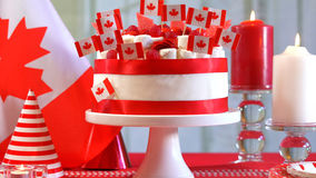 Canada Day national holiday celebration party table. With showstopper cake and flags stock photo