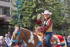 Canada Day Parade in Banff. Calgary Stampede Indian Princes waves at spectators at the Canada Day Parade in Banff, Alberta, on July 1st, 2012 in Banff. Canada Royalty Free Stock Images