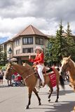 Canada Day Parade in Banff. Calgary Stampede Princesses wave at spectators at the Canada Day Parade in Banff, Alberta, on July 1st, 2012 in Banff. Canada Day is Royalty Free Stock Photos
