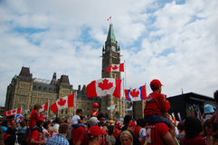 Canada Day in Parliament Hill, Ottawa. National Flags fly on Canada Day in Parliament Hill, Ottawa, Ontario, Canada Royalty Free Stock Images