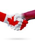 Canada de drapeaux, pays du Qatar, concept de poignée de main d'amitié d'association Photos libres de droits