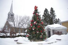 Canada, decorated fir in a village in the province of Quebec. Canada, decorated fir tree in a village in the province of Quebec under the snow during a cold royalty free stock images