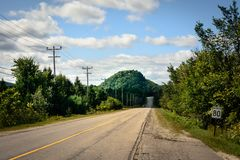 Canada - endless road and mountain Stock Images