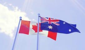 Canada et Australie, drapeaux ondulant contre le ciel bleu illustration stock