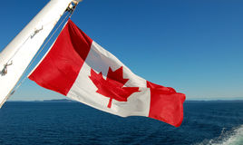 Canada Flag. Canada national flag waving on the sea Royalty Free Stock Images