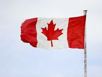 Canada flag. Canadian flag, flagpole against blue sky stock image
