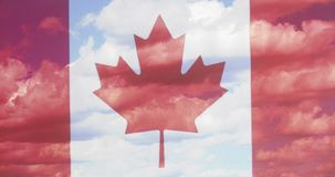 Canada flag a background of blue sky and clouds. Closeup Royalty Free Stock Images
