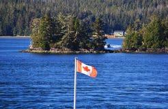 Canada Flag, Beautiful Pacific Ocean, Tofino, Vancouver Island, British Columbia, Canada.  Stock Photo