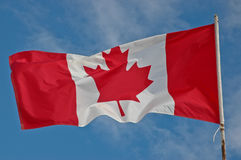 Canada flag on blue sky Royalty Free Stock Photography