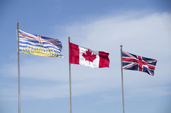 Canada flag. Flag of British Columbia, Canada and England, in Stanley Park, Vancouver BC, Canada stock photography