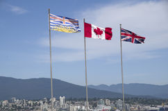 Canada flag. Flag of British Columbia, Canada and United Kingdom, in Stanley Park, Vancouver BC, Canada Stock Photo