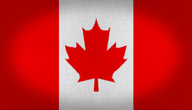 Canada flag. Canadian flag with three vertical stripes left and right in red and the middle one in white three leaf maple leaf also in red in the center, Fabric Stock Photo