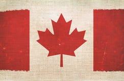 Canada Flag on Canvas. Background. Grungy Canadian Flag Royalty Free Stock Photos