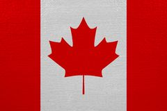 Canada flag on canvas. Patriotic background. National flag of Canada vector illustration