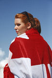 Canada Flag cape. A young girl draped in the Canada Flag stock photography