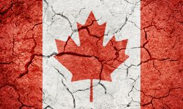 Canada flag. On dry earth ground texture background Stock Images