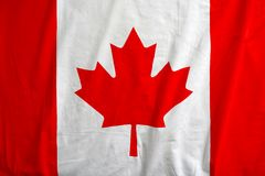Canada flag on the fabric texture background. Canada national flag background texture, fabric texture of the flag of Canada Stock Image