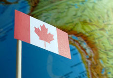 Canada flag with a globe map as a background Stock Photo