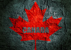 Canada flag maple leaf on grunge backdrop Royalty Free Stock Photo
