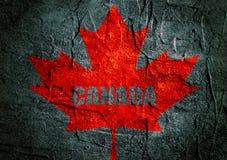 Canada flag maple leaf on grunge backdrop Royalty Free Stock Photo
