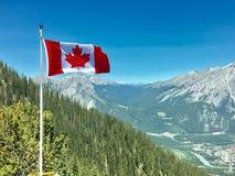 Canada Flag With Mountain Range View royalty free stock photos