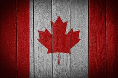 Canada Flag. Painted on old wood plank background stock images